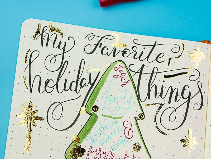 Sparkly Christmas Journal Pages. Fun #lettering and deco foil make a festive #journal favorites, Christmas books, and movie list. #bujo #christmaslist