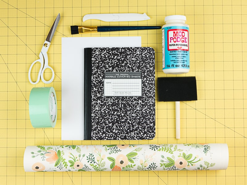 DIY journal from a boring composition notebook! This would make a cute Bullet Journal.
