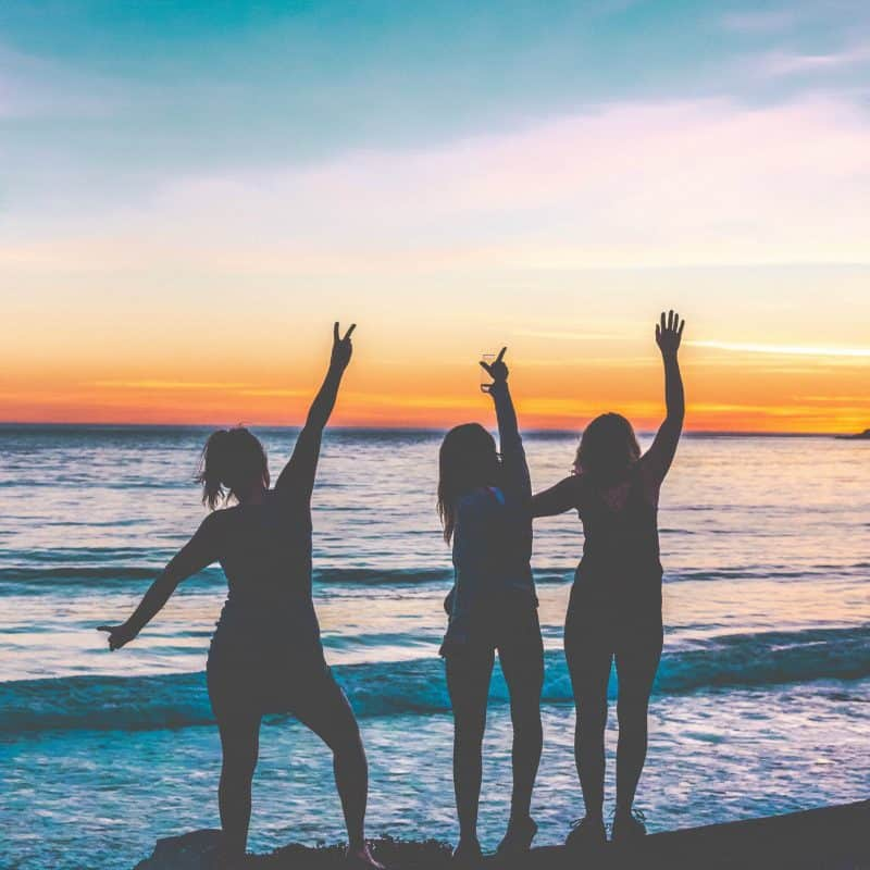 40 Ways to Practice Gratitude for happiness, mindfulness, and wellness. Photo of three friends on the beach at sunset. | pageflutter.com