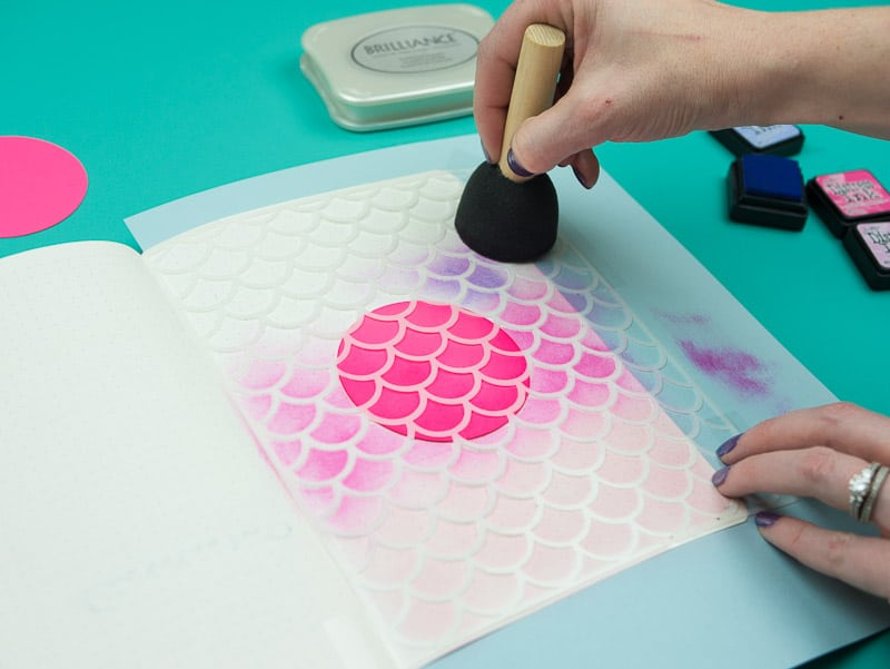 Stencil + Distress Ink Tutorial: Step 5, Continue swirling, work toward darker colors  pageflutter.com