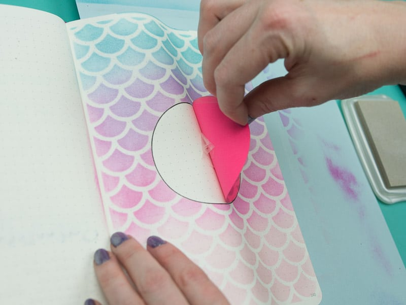 Stencil + Distress Ink Tutorial: Step 9, remove masking circle | pageflutter.com